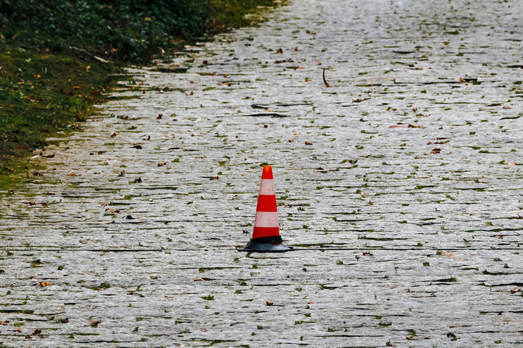 Day No People Red High Angle View Outdoors Nature Direction Safety Traffic Cone Footpath Wood - Material Security Land Protection Guidance Cone Plant Transportation Field Built Structure