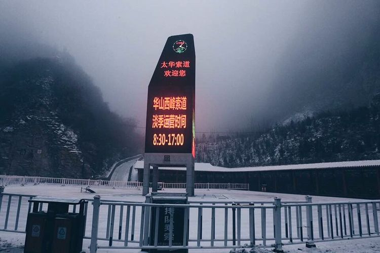 Information sign on snow covered road during winter