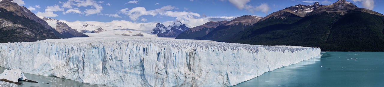 Famed Perito Moreno Glacier in Patagonia Argentino Lake Blue Color Dazzling Los Glaciares National Park Tourist Attraction  Argentina Beauty In Nature Body Of Water Clouds Day Environment Famous Place Glacier Mountains Natural Landmark No People Non-urban Scene Outdoors Patagonia Perito Moreno Picturesque Scenics - Nature Sky South America Travel Destinations