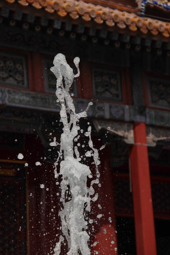 Art Is Everywhere Fountain Fountains Starting A Trip Traveling Adventure Architecture Art Buddism Building Exterior Built Structure Chinese Close-up Day No People Outdoors Place Of Worship Red Religion Roof Spirituality Splash Temple Water Waterfront