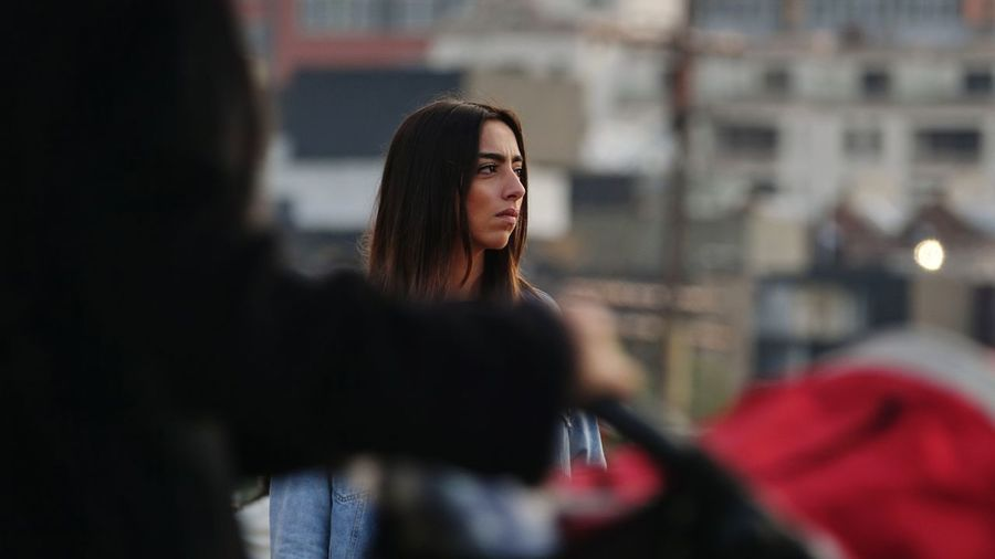 Close-up of young woman in city