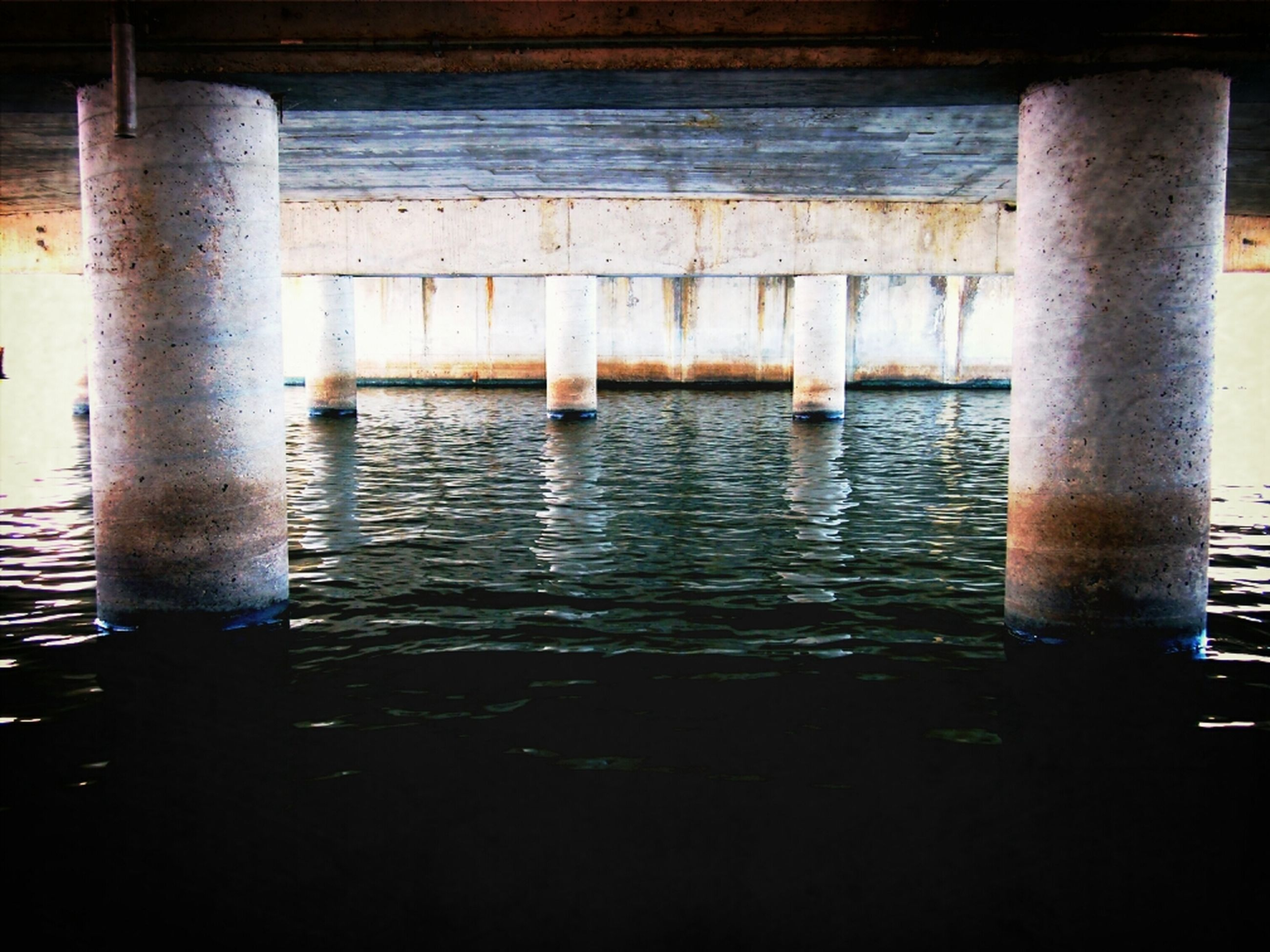 water, architecture, built structure, indoors, reflection, architectural column, waterfront, no people, column, river, day, pole, wood - material, sea, sunlight, support, window, rippled, building exterior