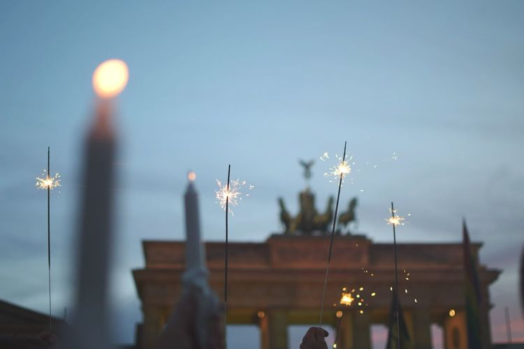Low Angle View Of Candles And Sparkles At Brandenburg Gate