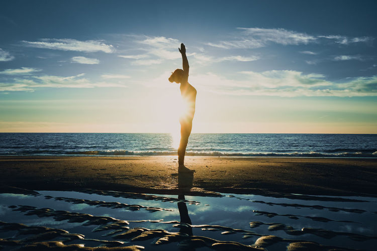yoga on the beach Exercising Happiness Lifestyle Morning Reflection Silhouette Summertime Woman Yoga Yoga Pose Beach Evening Healthy Lifestyle Outdoor Reflections Relax Relaxation Sand Silhouette_collection Summer Sun Sunset, Yogapose