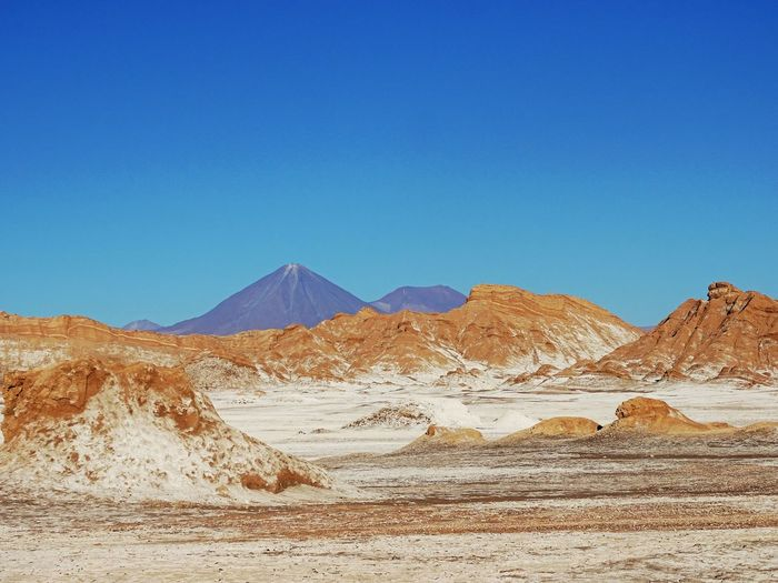 Scenic view of rock formations at atacama desert against clear sky