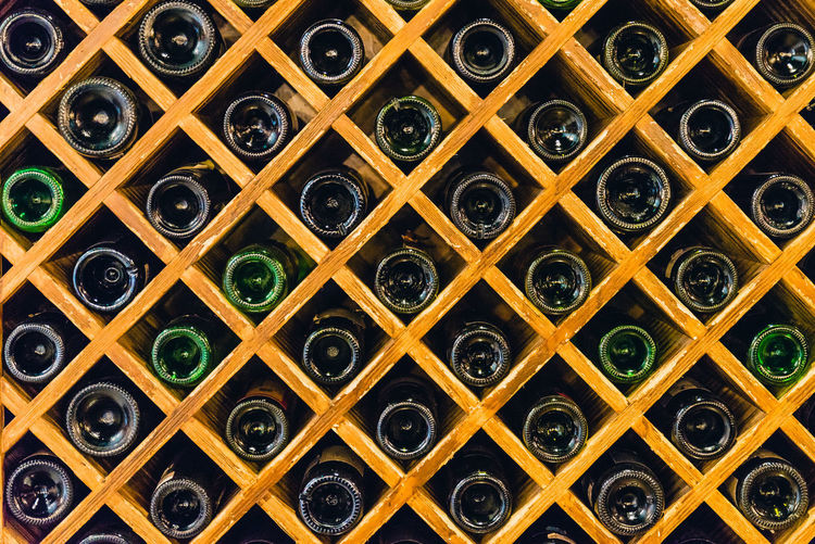 Alcohol Backgrounds Basement Bottle Cellar Drink Food And Drink Full Frame In A Row Indoors  Large Group Of Objects Pattern Rack Red Wine Shelf Storage Compartment Wine Wine Bottle Wine Cellar Wine Rack Winemaking Winery
