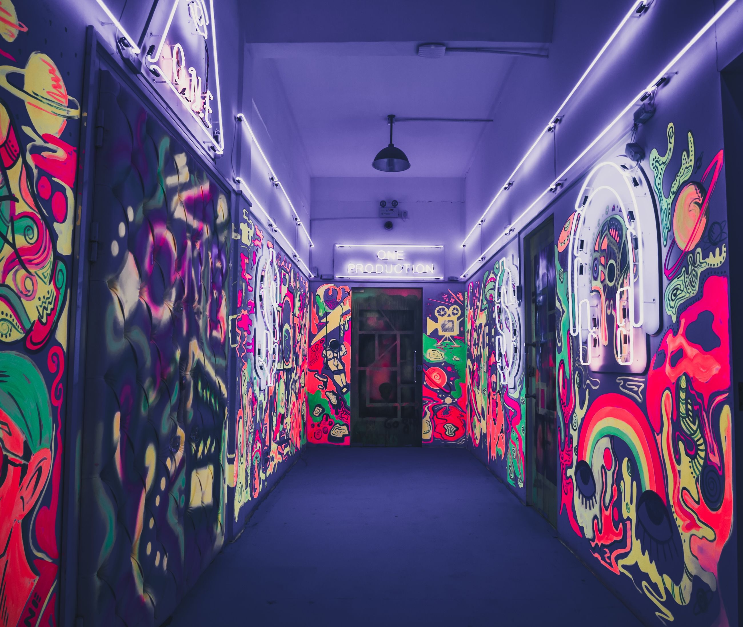 graffiti, art and craft, creativity, the way forward, multi colored, direction, illuminated, architecture, indoors, no people, wall - building feature, empty, absence, street art, lighting equipment, built structure, tunnel, diminishing perspective, text, paint, ceiling, light fixture