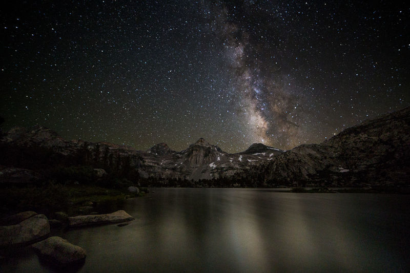 Just how I like it | Night fell at Rae Lakes. With that dropped the temperature like raindrops in the company of the gales of winds that never seemed to stop. Thankfully, the sky remained clear, letting me capture the Milky Way without a single clump of clouds. While my 15 degree sleeping bag certainly kept me warm, the howling screams of the winds were deafening at the edge of this rockbed jutting into the water. Meanwhile, the galaxy rose above Painted Lady and Glen Pass. Just how I like it. Kings Canyon National Park, CA Glen Pass Kings Canyon National Park Painted Lady Rae Lakes Astronomy Beauty In Nature Galaxy Illustration Lake Long Exposure Milky Way Mountain Mountain Range Nature Night No People Outdoors Scenics Sierra Nevada Sky Star - Space Tranquil Scene Tranquility Water Waterfront