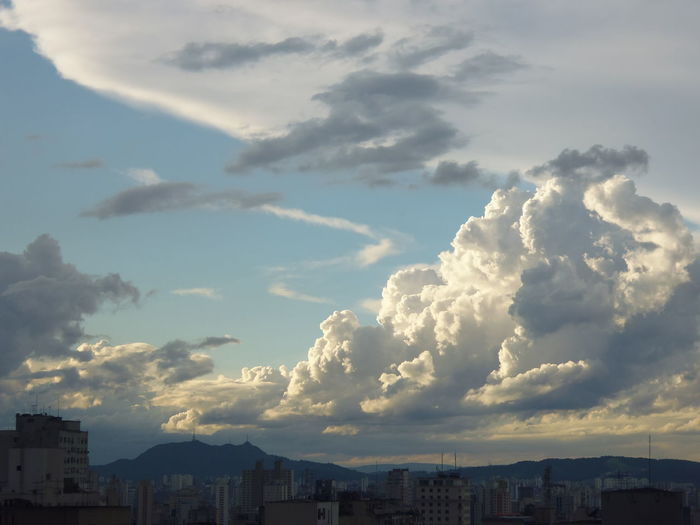 """Afternoon Clouds with the """"Pico do Jaraguá"""" Mountain Susan A. Case Sabir Unretouched Photography Afternoon Sky Beauty In Nature Building Exterior Built Structure City Cityscape Cloud - Sky Day Downtown São Paulo High Angle View Mountain In The Distance No People Outdoors Pico Do Jaragua Sky Voluptuous Clouds"""