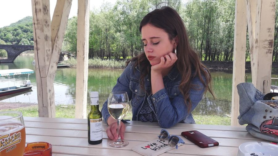 Wine Not Only Women Sitting One Person Water Day Outdoors Wine Wine Bottle Newoneyeem One Woman Only Nature Beauty In Nature River