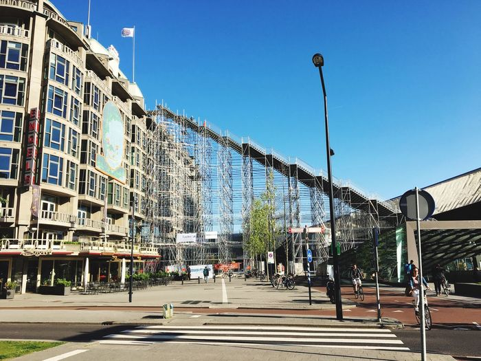 Low Angle View Of Scaffoldings At Rotterdam Centraal Station On Sunny Day