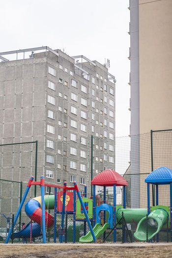 Absence Apartment Architecture Building Building Exterior Built Structure Chair City Clear Sky Day Empty Green Color Multi Colored Nature No People Outdoor Play Equipment Outdoors Playground Seat Sky Slide - Play Equipment My Best Photo