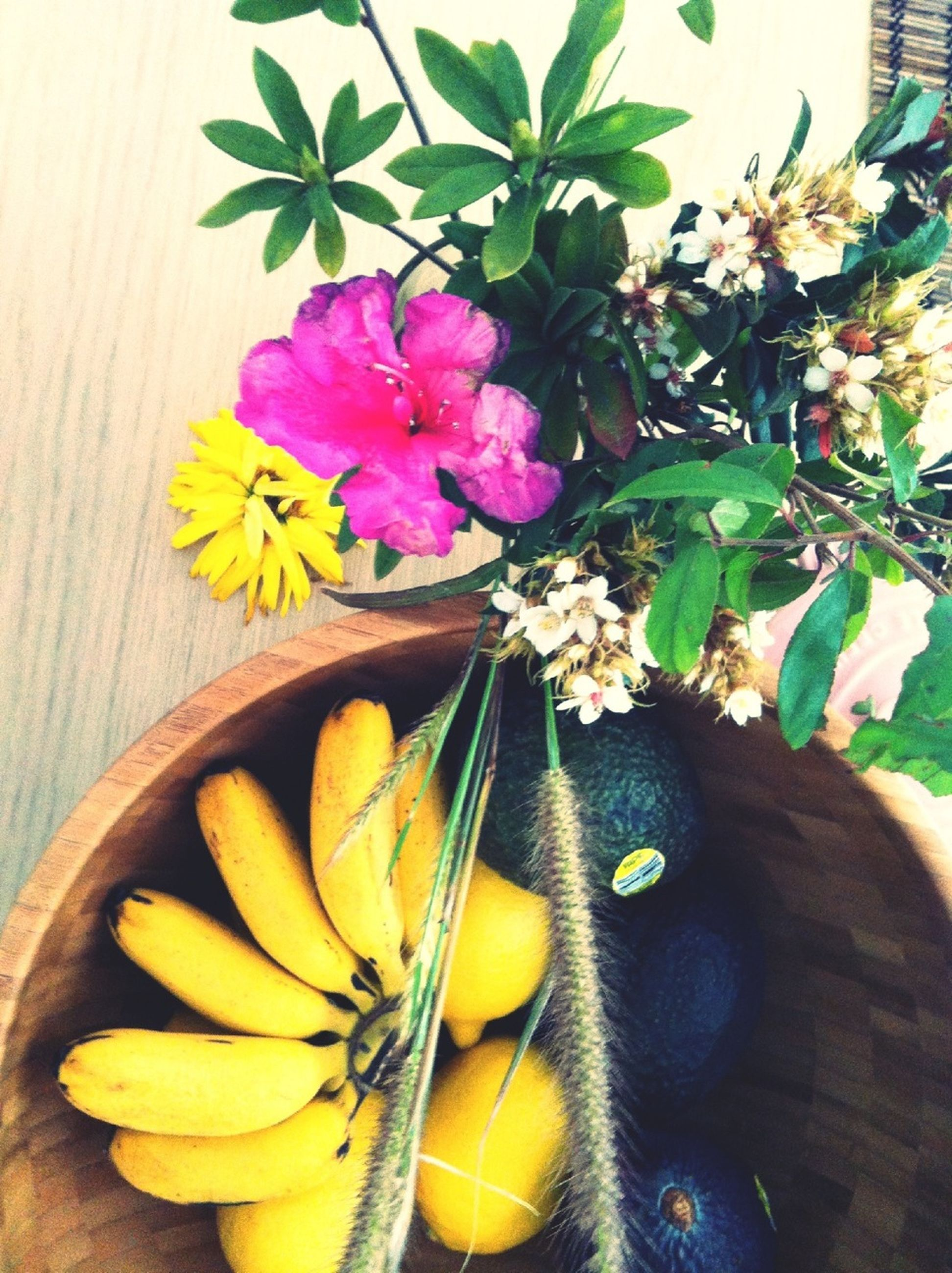 flower, freshness, yellow, table, high angle view, still life, indoors, fragility, wood - material, close-up, food, petal, food and drink, wooden, no people, leaf, vase, day, fruit, flower head