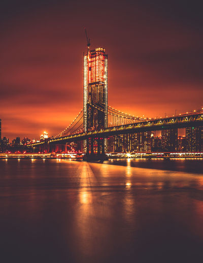 View of Manhattan Bridge at night. Brooklyn Moody Sky New York City Architecture Bridge - Man Made Structure Built Structure City Cityscape Illuminated Manhattan Bridge Moodygrams Night Reflection Skyscraper Suspension Bridge Travel Destinations Urban Skyline Waterfront