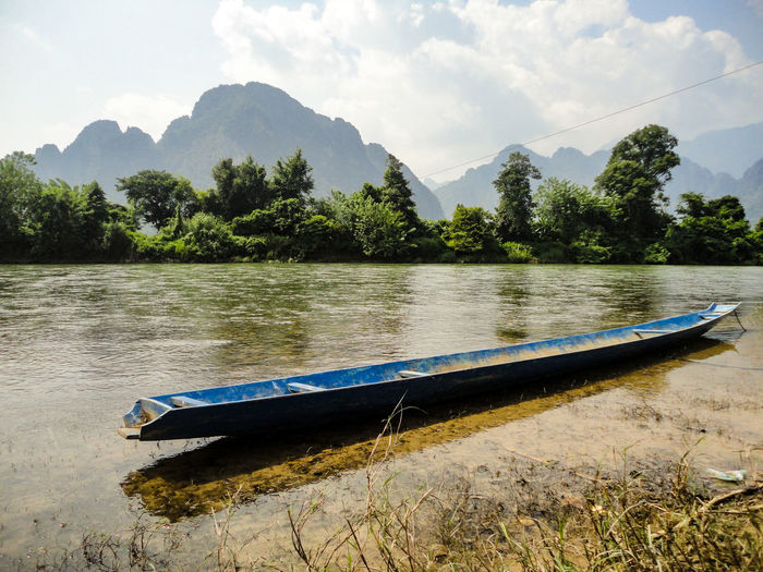 Long Boat Vang Vieng Laos Copy Space Minimalism Water Travel River Calm River Water Nautical Vessel Tree Nature Landscape Outdoors No People Day Mountain Range Water Reflections