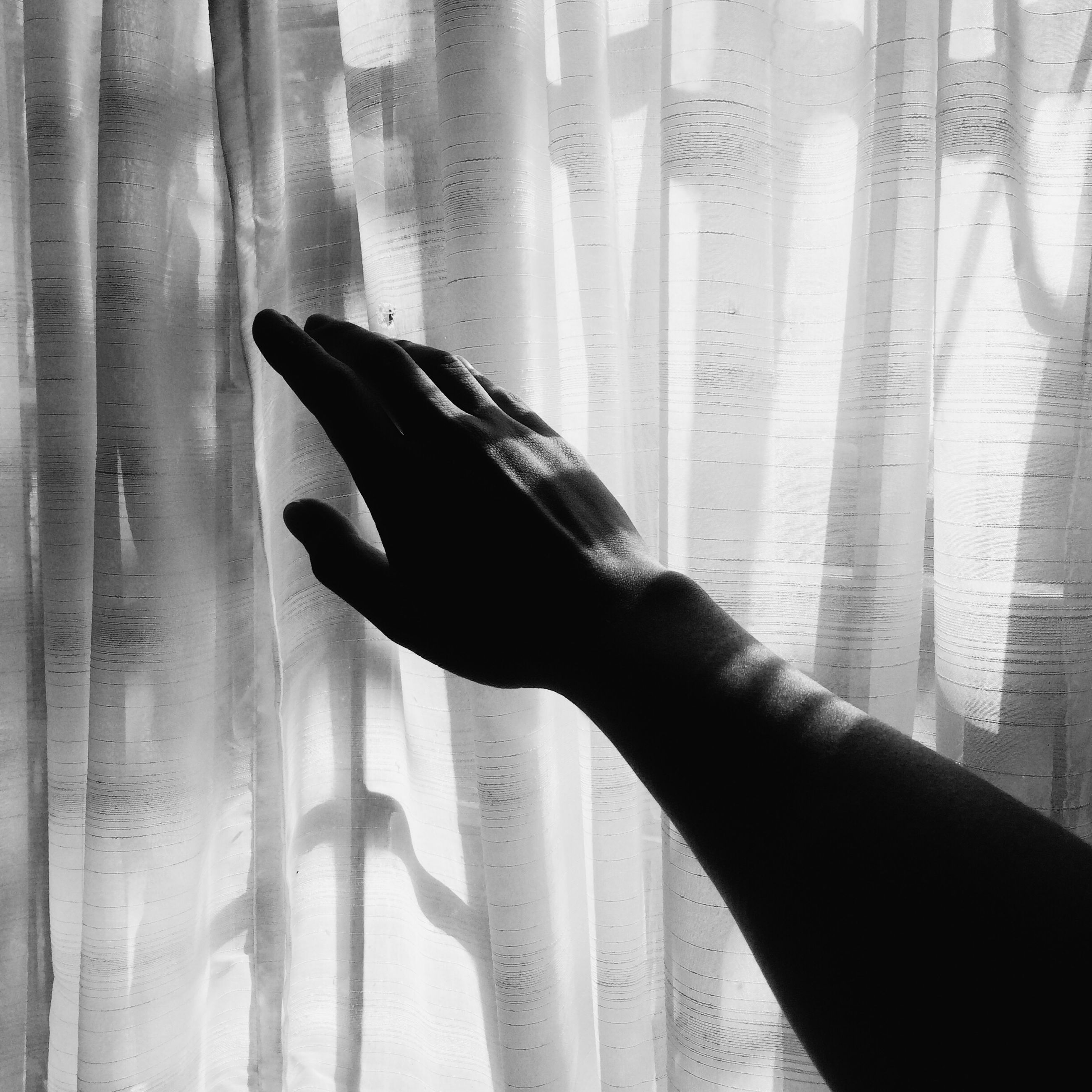 person, indoors, part of, human finger, cropped, lifestyles, unrecognizable person, curtain, close-up, low section, personal perspective, home interior, shadow, leisure activity, holding