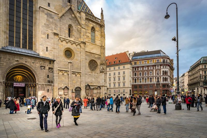 Urban life in the evening at Stephansplatz square, The geographical centre of Vienna. Architecture Building Exterior Built Structure City City Life Large Group Of People Person Sky Tourism Tourist Travel Destinations