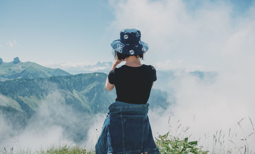 Rear view of woman wearing hat looking at view