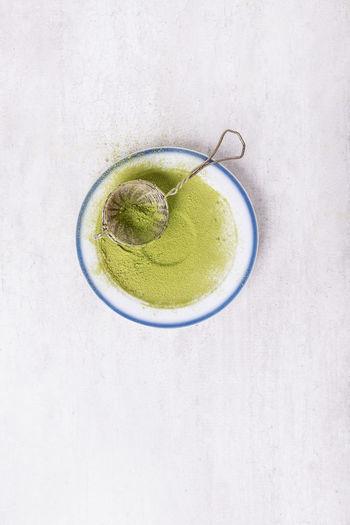 High angle view of green tea cup