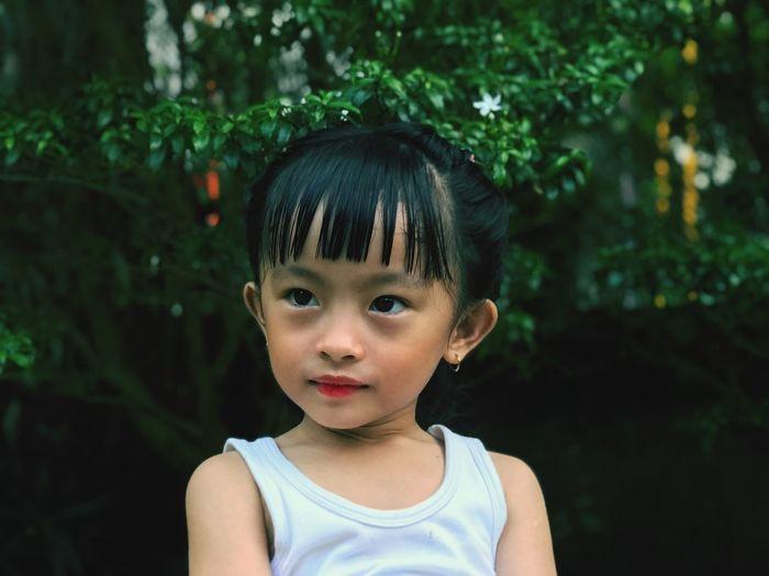 Close-up of cute girl looking away
