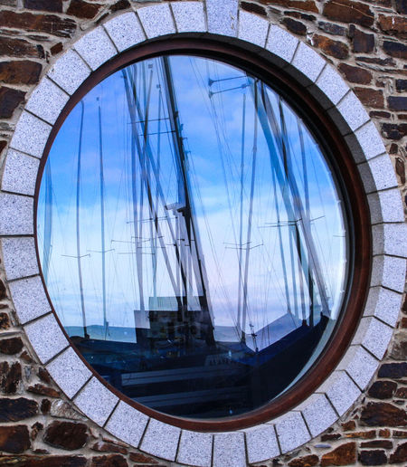 Architecture Brickwork, Wall Building Exterior Built Structure Circular Window Close-up Cornwall Day England Looe Harbour Masts No People Outdoors Reflection Sky