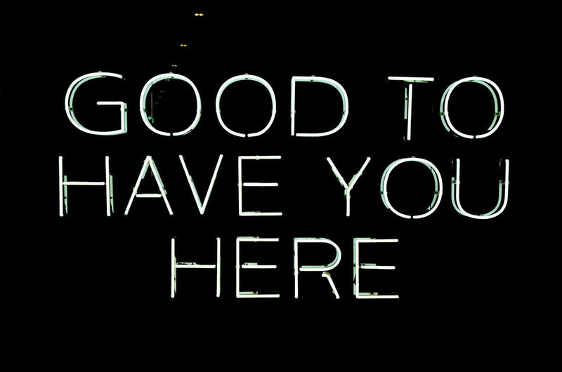 GOOD TO HAVE YOU HERE Text Western Script Communication Night Illuminated Capital Letter Neon Black Background Information Sign No People Indoors  Lighting Equipment Studio Shot Dark Glowing Close-up Information Sign Single Word Letter Message Consumerism Neon Sign EyeEm Best Shots EyeEm Selects EyeEm Gallery