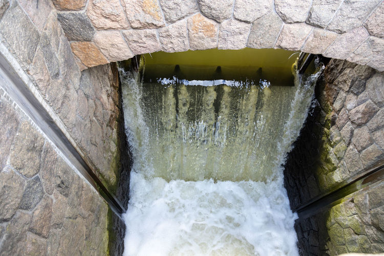 Scenic view of water flowing through wall