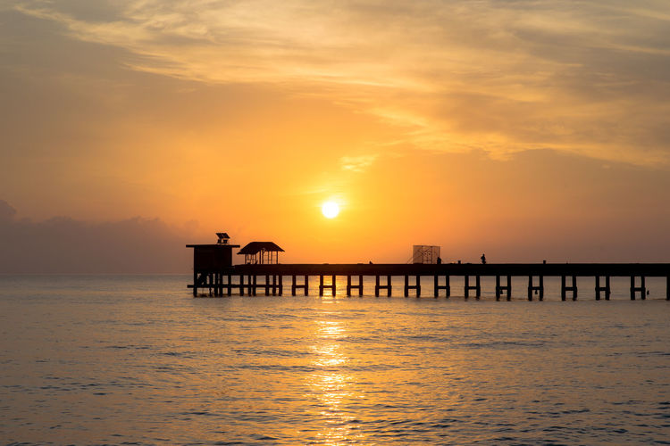Sunset Water Sky Sea Beauty In Nature Scenics - Nature Cloud - Sky Nature Built Structure Outdoors