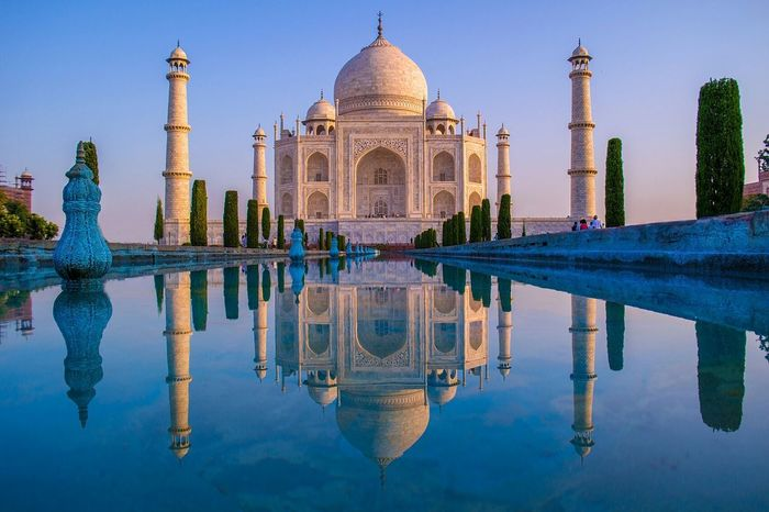 Last year I went to taj mahal for the 2nd time. I woke up at 5am to catch the early morning sunrise and to avoid the huge crowds.. im always stunned by this symbol of love Taj Mahal Sunrise Reflections Water Reflections Landscape Travel Photography Clouds And Sky Seven Wonders Of The World The Architect - 2015 EyeEm Awards Water Reflections