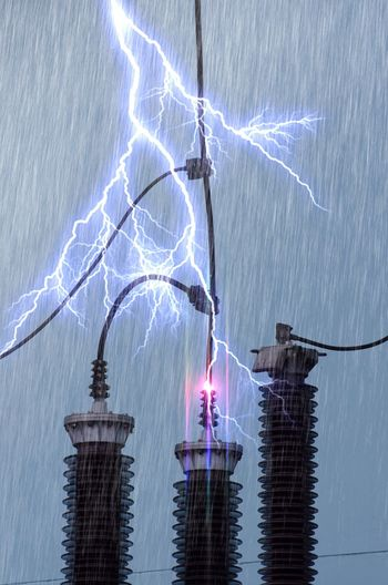 Thunder and lightning On the high voltage poles. Lightning Thunder High Voltage Poles. Illuminated Architecture Built Structure Water No People Building Exterior Night Firework Celebration Beauty In Nature City Long Exposure Building Lighting Equipment Event Outdoors Low Angle View Nature Sky Motion