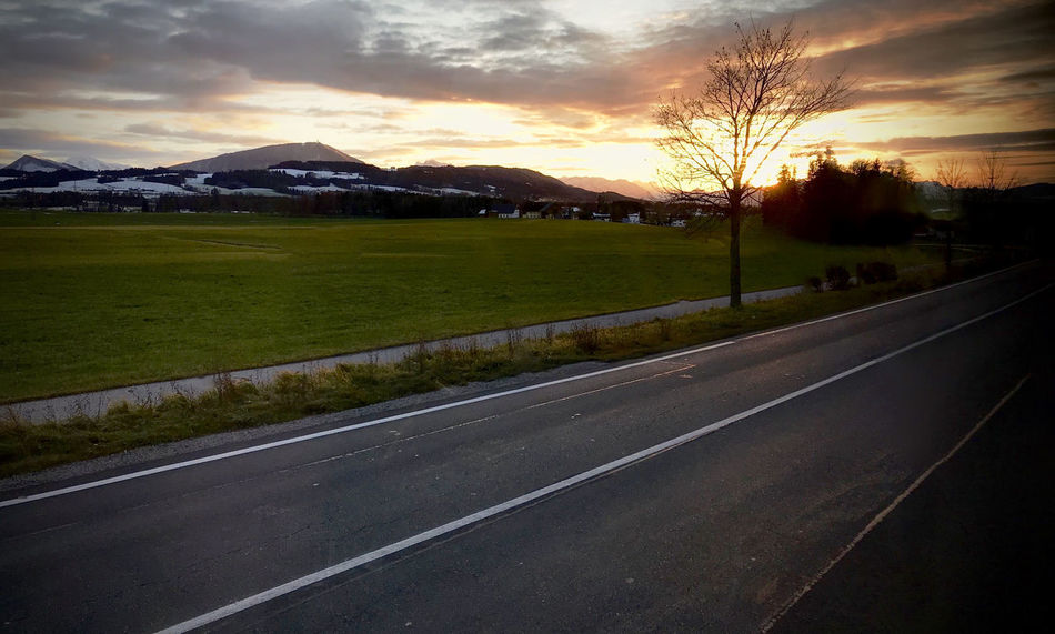 Sun sets in the beautifull Red Austria Green Hills Path Red Tree Beauty In Nature Beauty In Nature Cloud - Sky Clouds Day Evening Grass Landscape Landside Mountain Nature No People Outdoors Road Salzburg Sky Sunset The Way Forward Tree