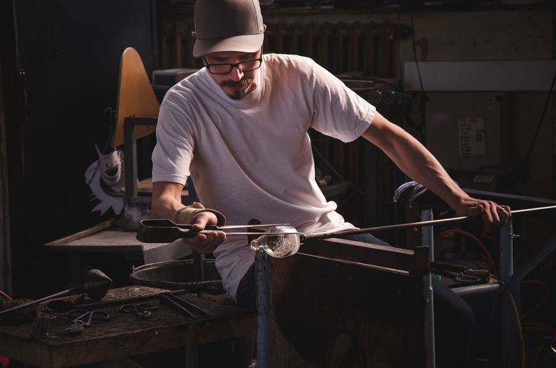 Man working on glass at workshop