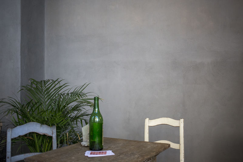 Close-up of bottle on table at home