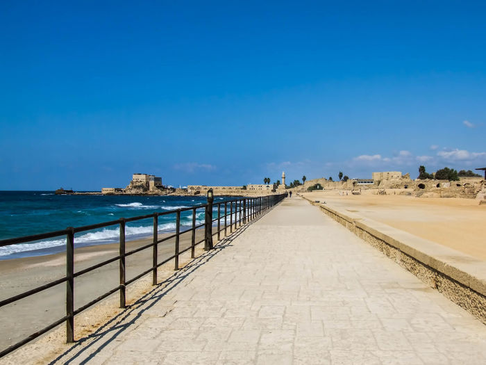 Caesarea's Antiquities Park Ancient, Antique, Archeology, Architecture, Art, Asia, Background, Beach, Beauty, Bible, Blue, Brick, Bright, Building, Caesarea, Calm, City, Clouds, Coast, Coastline, Construction, Culture, Harbor, History, Holy, Israel, Judea, Landmark, Landscape, Lines Beauty In Nature Blue Caesarea, Israel, Keysarya, Palestine, Arab, Jew, Israeli, Palestinian Caesarea's Antiquities Park Clear Sky Day Diminishing Perspective Empty Fishing Harbor Horizon Over Water King Herod, Augustus Caesar, Caesar Long Narrow Nature Outdoors Scenics Sea Sky The Way Forward Tranquil Scene Tranquility Vanishing Point Walkway Water