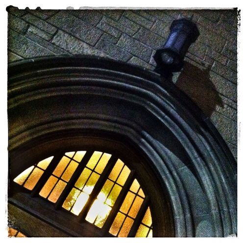 Archway, lamp and shadow. YYC IPhone Church Photography