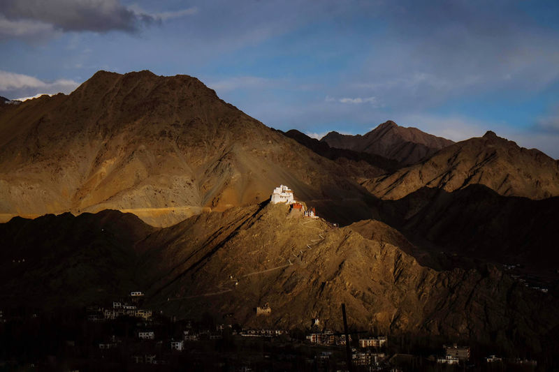 Scenic view of mountain and sunset light shining on leh palace