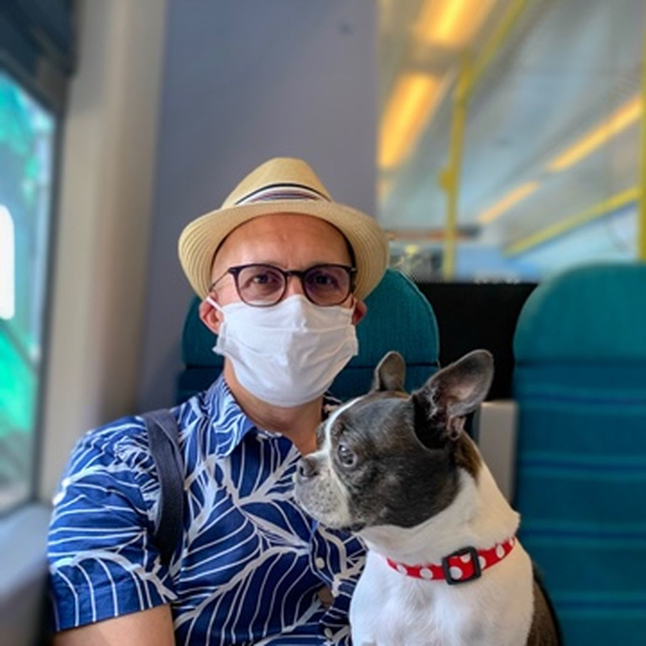 PORTRAIT OF MAN WITH DOG WEARING MASK