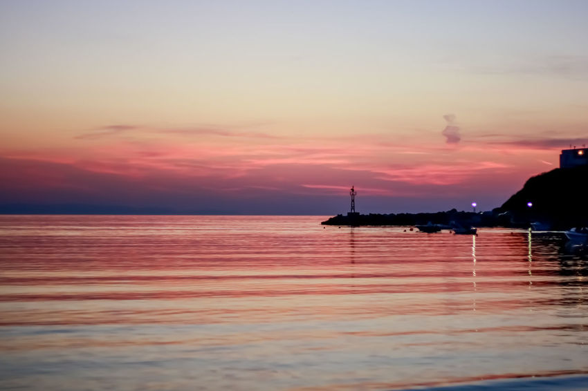 After the sunset colors of the sky reflecting to the sea ! Romantic Mood Architecture Beach Beauty In Nature Before Dark Cloud - Sky Day Horizon Over Water Kınık Nature No People Outdoors Pink Reflections Scenics Sea Silhouette Sky Sunset Syros Ermoupoli Greece Tranquil Scene Tranquility Travel Destinations Water Breathing Space