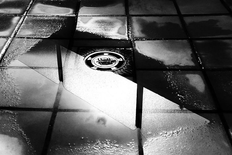 High angle view of wet tiled floor