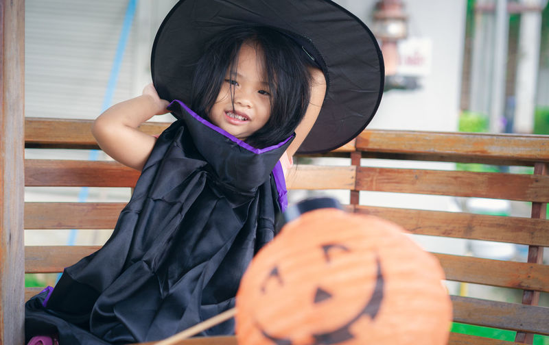 Little girl in a witch costume and lamp in halloween Halloween Happiness Happy Holiday Asian Girl Child Childhood Clothing Costume Cute Front View Holding Innocence Lamp Leisure Activity Lifestyles Little Girl One Person Portrait Real People Seat Sitting Smiling Witch Women