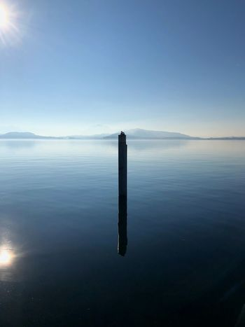Reflection Lake Reflection Lake Reflections In The Water Tranquility Tranquil Scene Water Scenics Sea No People Beauty In Nature Nature Sky Day Wooden Post Outdoors Horizon Over Water Blue Clear Sky