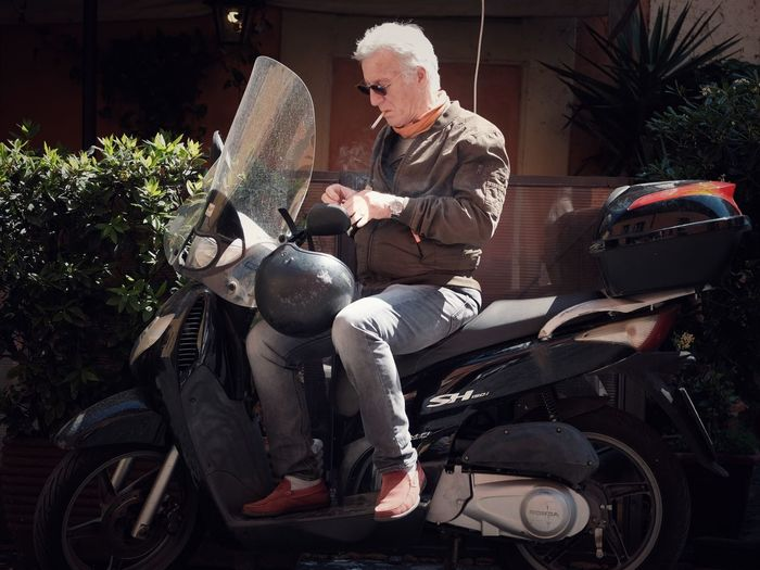 Moto Man Vespa Smoking Streetphotography Street Portrait EyeEm Best Shots Real People Males  Men Sitting Leisure Activity Lifestyles One Person Senior Men Motorcycle Transportation Casual Clothing