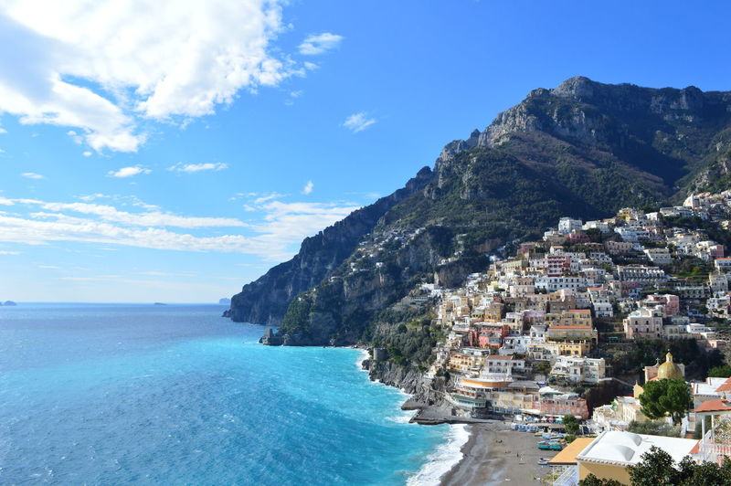 View of Positano from the main road. Architecture Beauty In Nature Blue Built Structure Cloud Cloud - Sky Coastline Day Mountain Mountain Range Mountain View Mountains Mountains And Sky Nature Outdoors Residential District Rock Formation Scenics Sea Sea And Sky Seaside Sky Town Tranquility Water