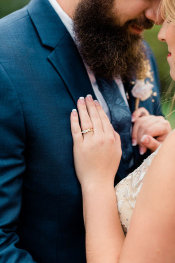 Midsection of couple with hands