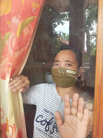 Portrait of a boy holding a window