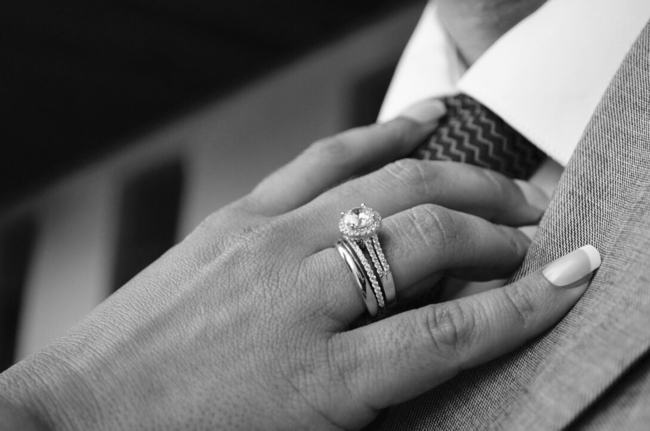human hand, ring, wedding, wedding ring, engagement ring, close-up, men, human body part, jewelry, life events, real people, love, celebration, women, indoors, bride, finger ring, two people, togetherness, diamond ring, groom, married, bridegroom, day, people