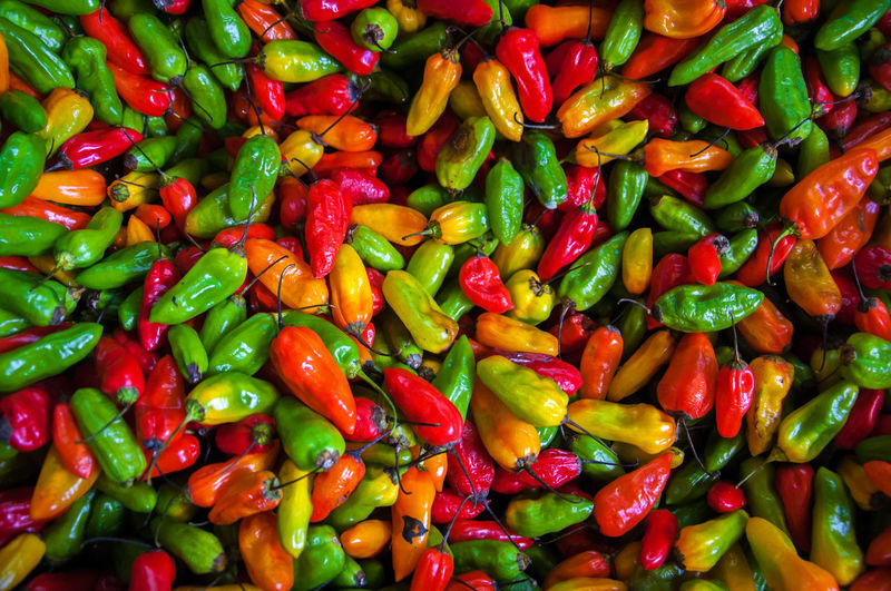 Red, orange, yellow, and green chili peppers America Bogotá Capital Chili  City Colombia Cook  Culture Food Fresh Green Hot Ingredient Orange Pepper Red South America Spice Spicy Tourism Tradition Travel Urban Vegetable Yellow