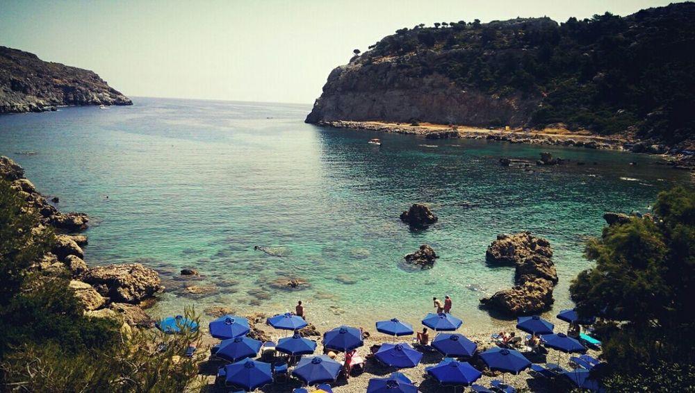 This beach is heaven...Anthony Quinn Bay in Rhodes, Greece Life Is A Beach Beach Photography Beach Bay Greece Rhodes Ródos Blue Sea Beach Nature