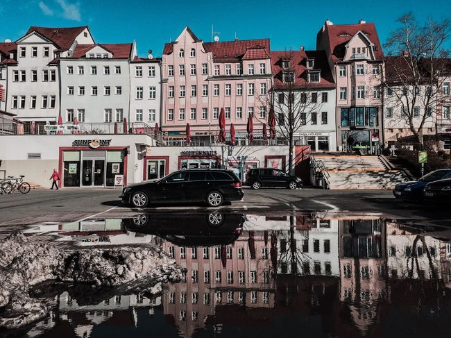 Jena Eichplatz OldButGold Facades Jena Parking Shopping ♡ Reflection Puddle Architecture Building Exterior Built Structure Transportation Mode Of Transport Day Outdoors City Sky