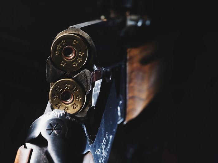 Close-Up Of Shotgun In Darkroom